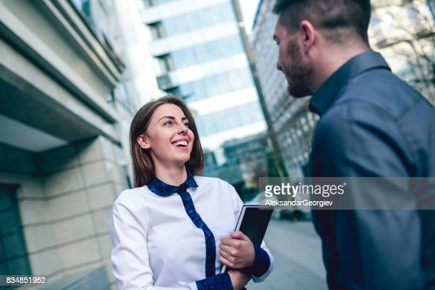 Young Business Female Student Meeting Mentor Assistent in CIty Street