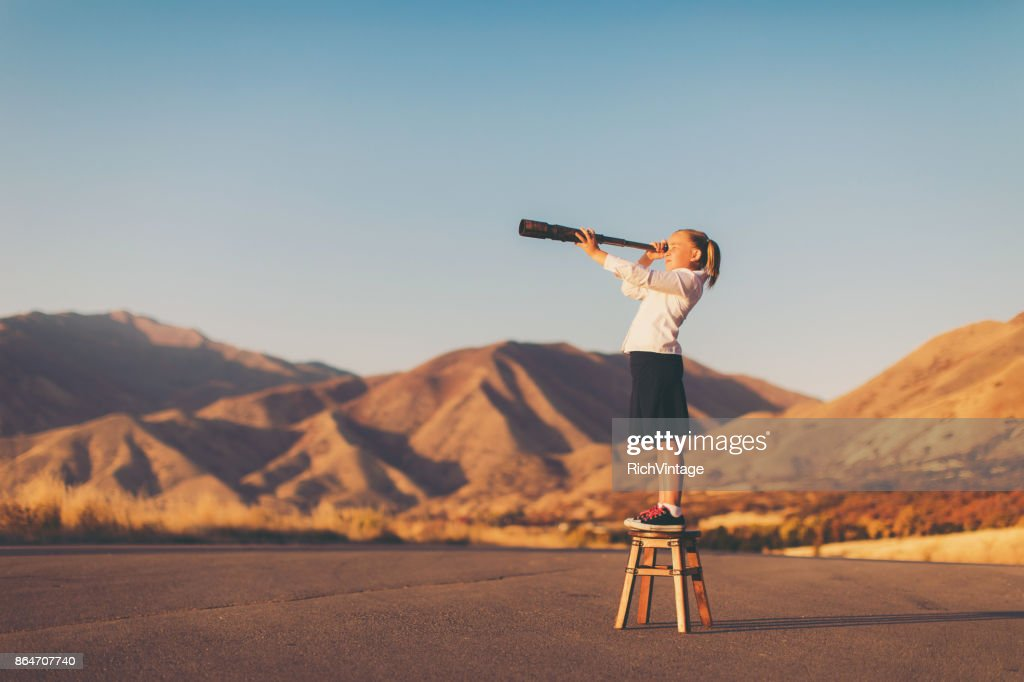 Young Business Girl Looks through Telescope : Stock Photo