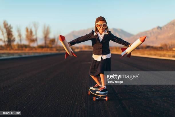 young business girl riding skateboard with rockets - launch event stock pictures, royalty-free photos & images