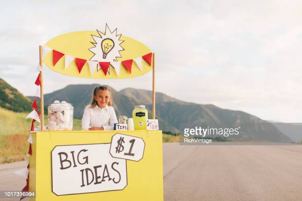 Young Business Girl Runs Big Idea Stand