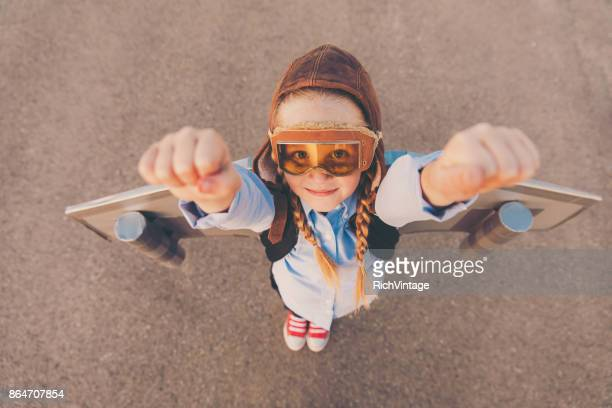 Young Business Girl with Jet Pack Raises Arms