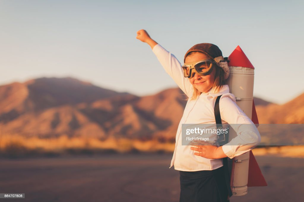 Young Business Girl with Rocket Pack : Stock Photo