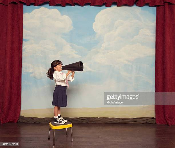 young business girl yells through megaphone - uitvoerende kunst voorstelling stockfoto's en -beelden