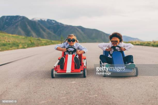 young business girls race go carts - lust girl stock photos and pictures
