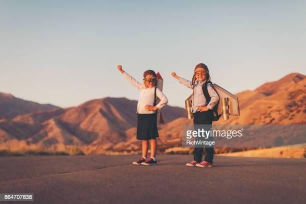 Young Business Girls Wearing Rockets