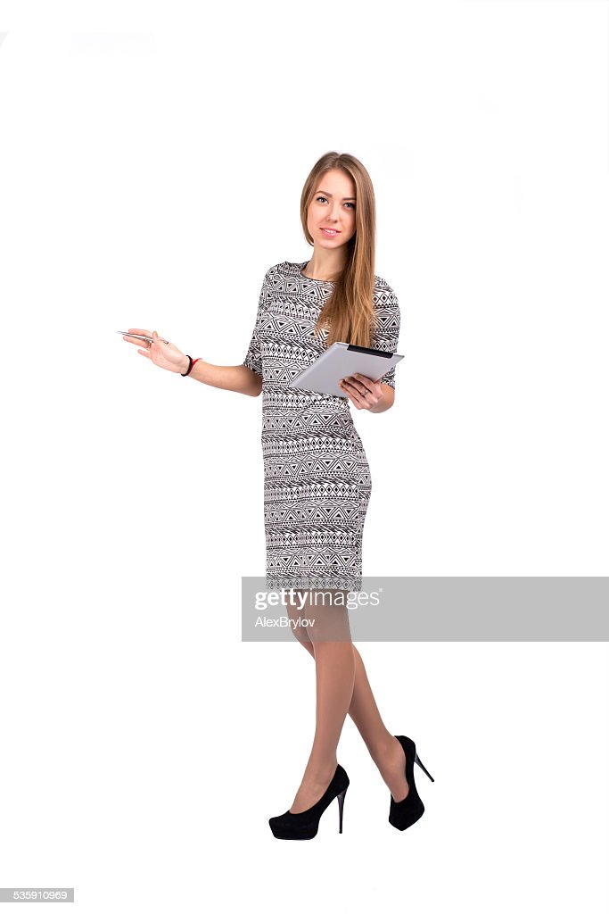 Young business lady with tablet PC and open hand : Stock Photo