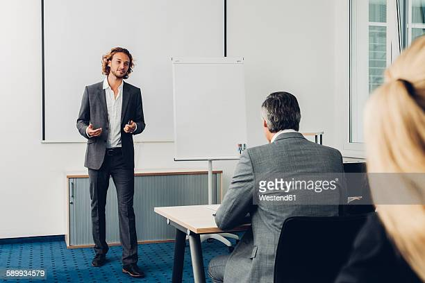 Young business man giving presentation