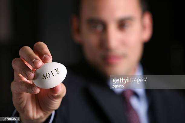 Young business man holding egg