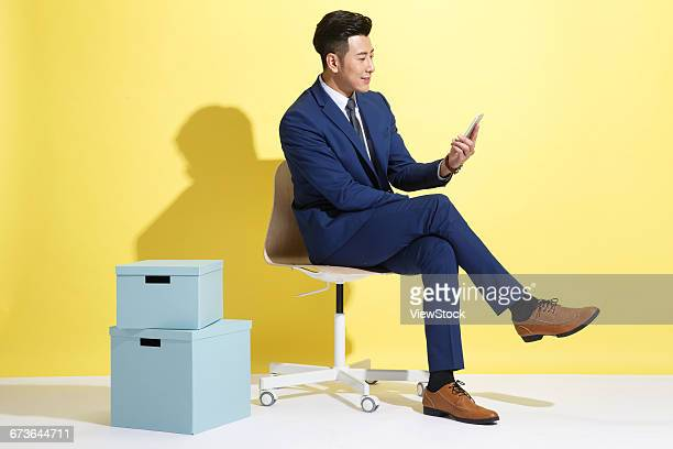 Young business man looking at mobile phone