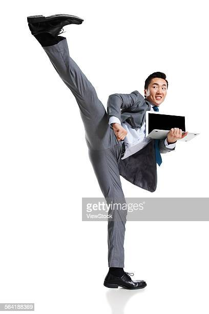 A young business man practicing kung fu