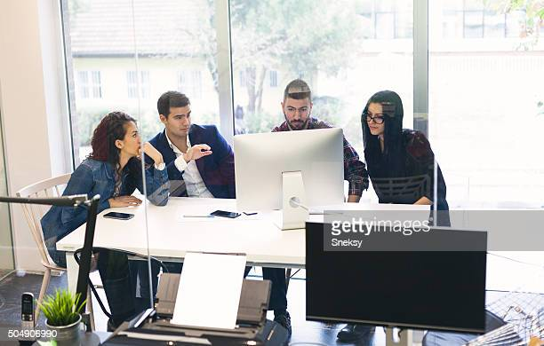 Young business man presents ideas to his team