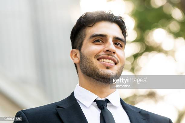 young business man smiling - north african ethnicity stock pictures, royalty-free photos & images