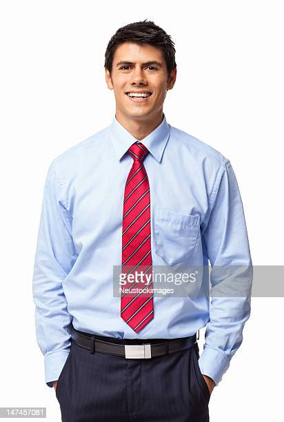 Young business man smiling with hands in pockets