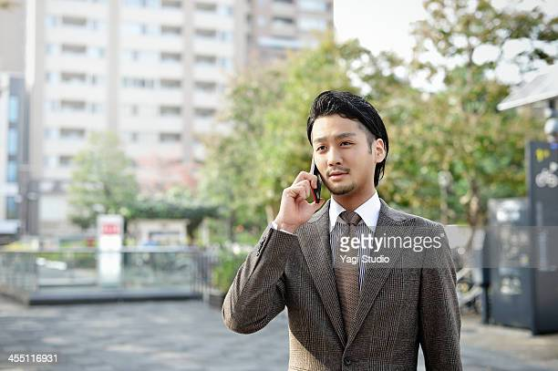 Young business man using smartphone in the city