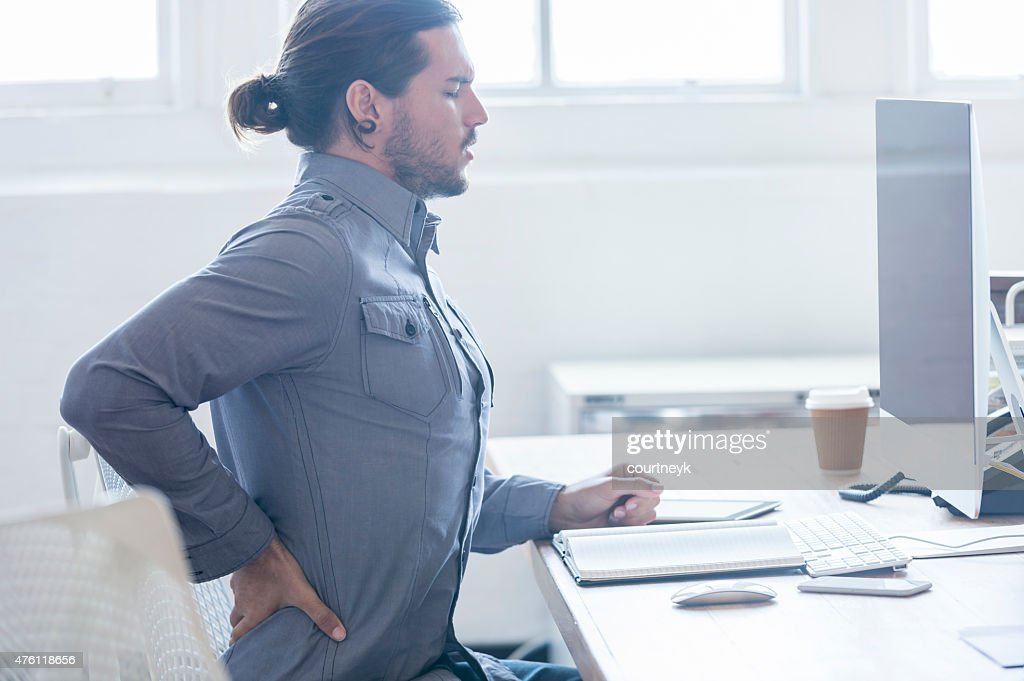 Young business man with holding his back in pain. : Stock Photo