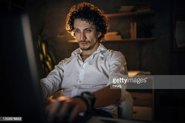 young business man working at night - frustration stock pictures, royalty-free photos & images