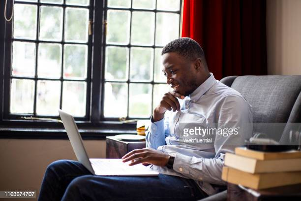 Young business man working from home using a laptop