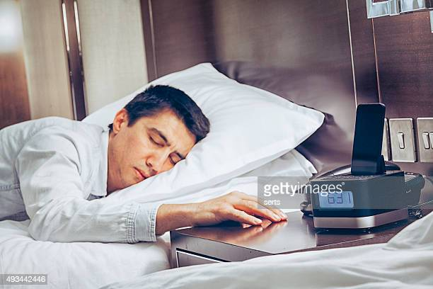 Young business man zonk out and fall asleep on bed