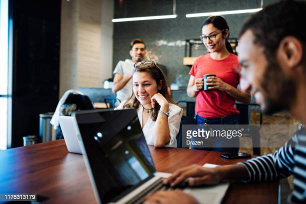 young business people and entrepreneurs working in latin american start-up - youth culture stock pictures, royalty-free photos & images