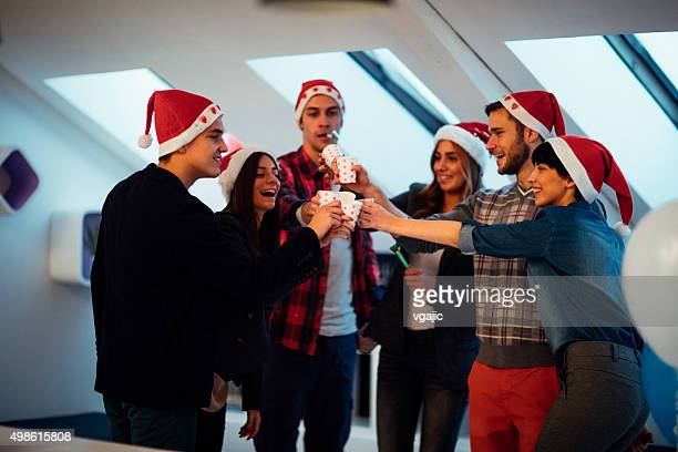 Young Business People Celebrating Christmas in Their office.