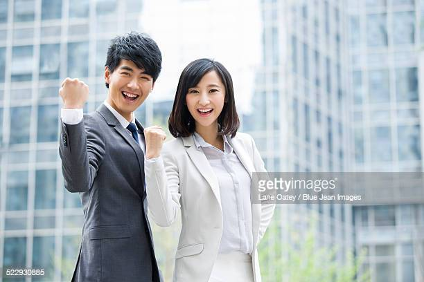 Young business people cheering