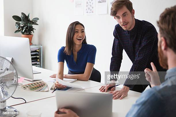Young business people discussing in office