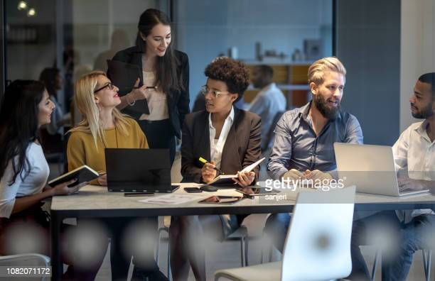 young business people having a meeting - staff meeting stock pictures, royalty-free photos & images