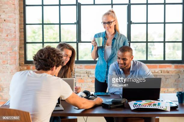 Young business people in office preparing foundation of a start-up company