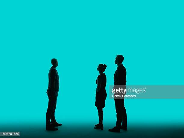 3 young business people  in siloette - three people stock pictures, royalty-free photos & images