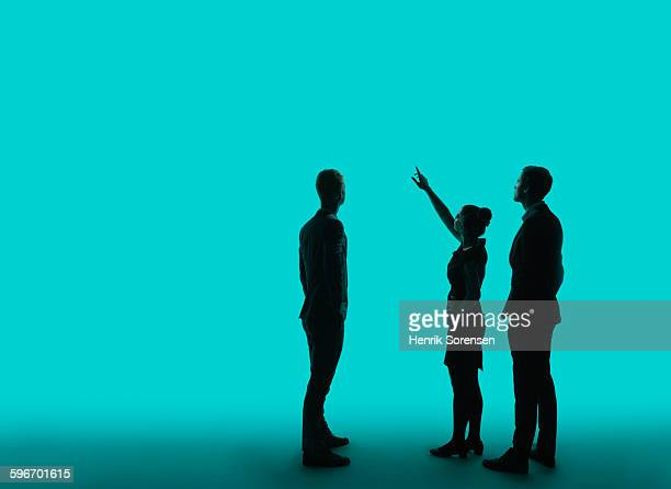 3 young business people  in siloette - in silhouette stock pictures, royalty-free photos & images
