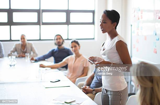 Young business people meeting in a conference room