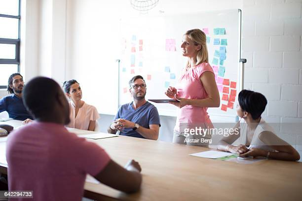 young business people meeting in a conference room - vanguardians stock pictures, royalty-free photos & images