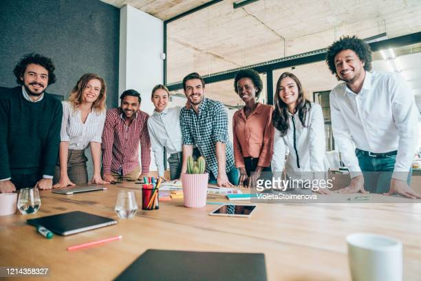 young business people on meeting in board room. - ethnicity stock pictures, royalty-free photos & images