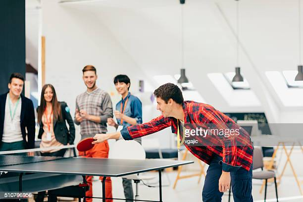 Young Business People Playing Table Tennis In Their Office