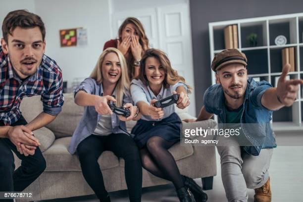 Young business people playing video games in the office