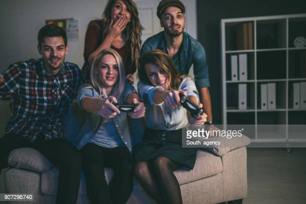 Young business people playing video games in the relax room
