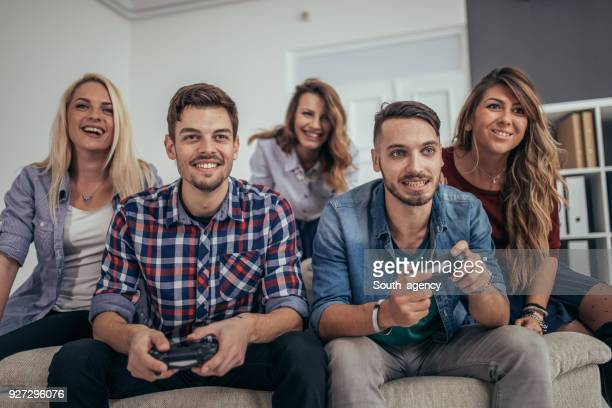 Young business people playing video games