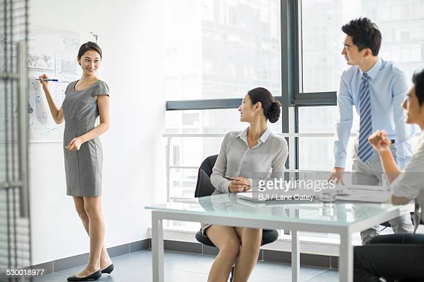 Young business people talking in meeting