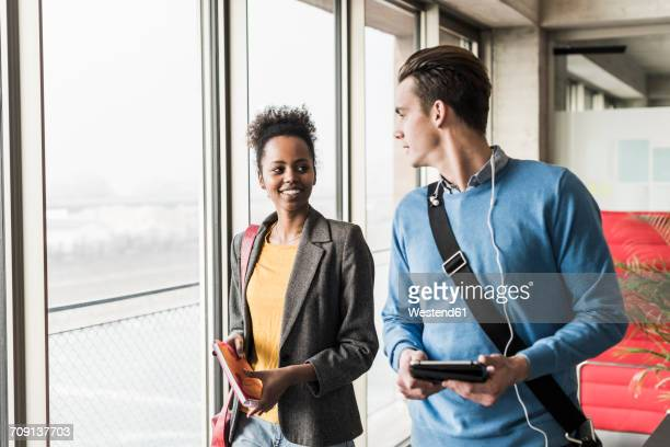 Young business people walking together in office