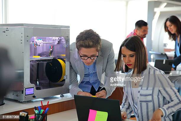 Young Business People working in 3D printer office