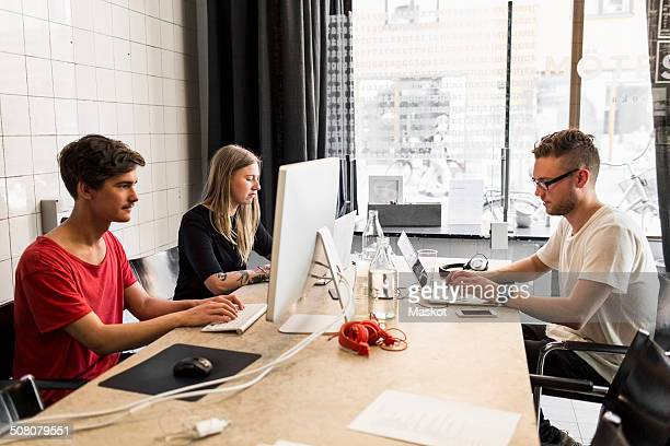 Young business people working in new office