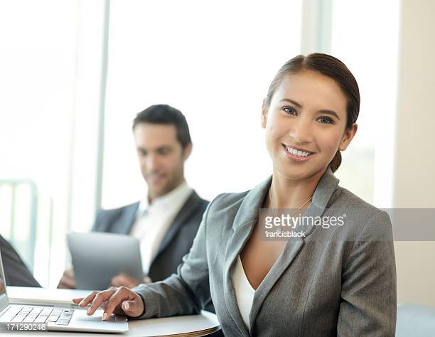 young business people working on digital devices - philippines stock pictures, royalty-free photos & images