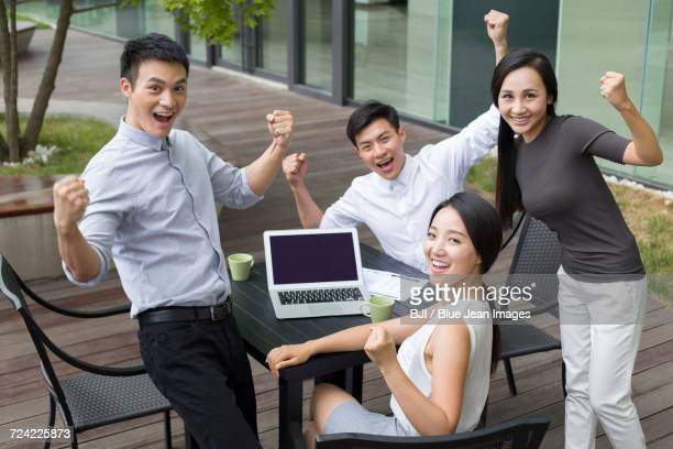 young business person cheering outdoors - ノースリーブ ストックフォトと画像
