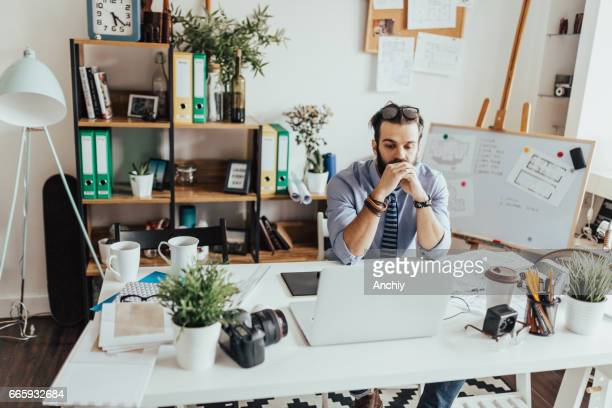 Young business person is daydreaming in the home office