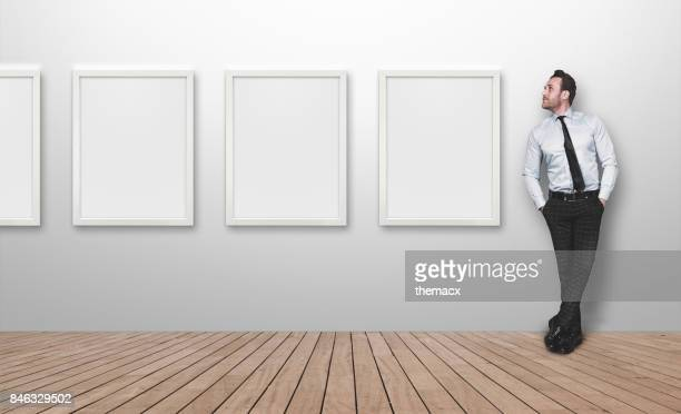 Young business person looking blank picture frames