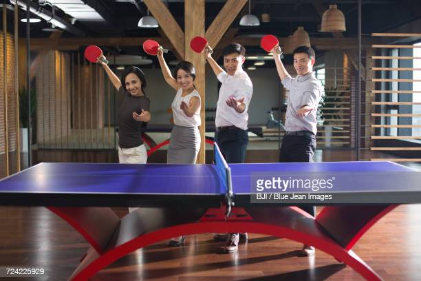 Young business person playing ping pong