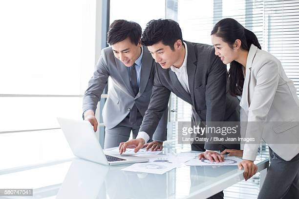 Young business person talking in meeting room