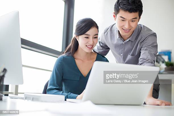 young business person talking in office - open collar stock pictures, royalty-free photos & images