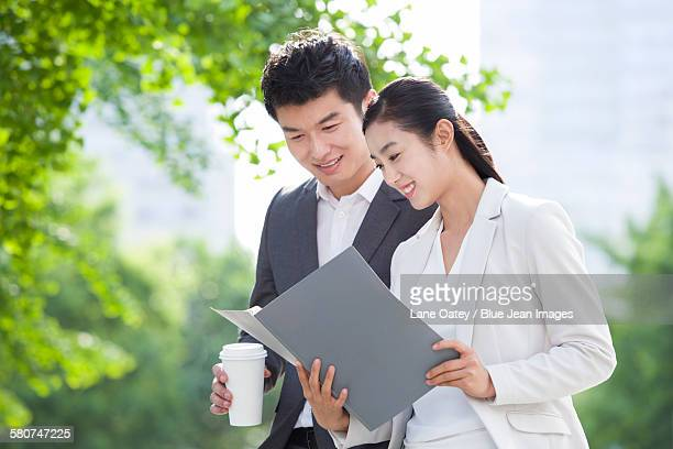 Young business person working with coffee outdoors