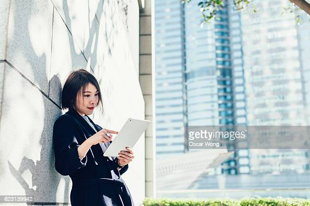 Young business reading email on tablet